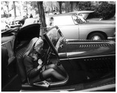Catherine Deneuve in her Morgan roadster, 1967.