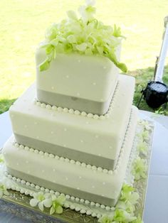 Wedding Cake: Square white and gray wedding cake with green flowers