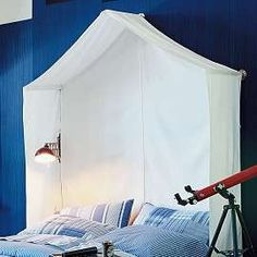 """Create an Indoor Fort with a Canvas """"Tent"""" Canopy...Perfect for a Boys Room."""