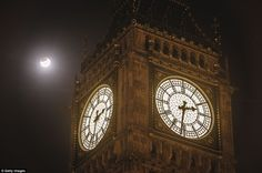 UK: The super blood moon is seen during the early stages of the lunar eclipse near Big Ben in Westminster - 28th September 2015