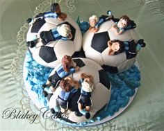 Soccer ball cake with fondant team players/BlakeyCakes