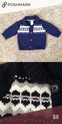 Navy Blue Baby Cardigan Sweater is more like a dark navy and not as light as shown in picture. Worn 1-2 times. In excellent condition. Almost like new. Has a cute design in front. Warm and comfortable for the fall and winter. Carter's Shirts & Tops Sweaters
