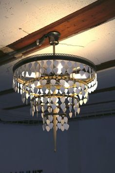 Upcycled chandelier from guitar picks and one drumstick - bet we could figure out a way to use more than one drumstick!