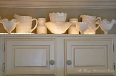 uplight milk glass on top of kitchen cabinets