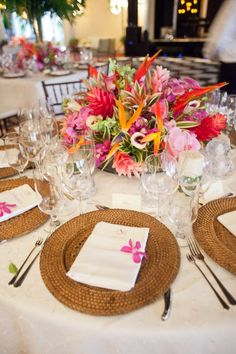 Bold Tropical Floral Reception Table Centerpiece. I love these but on a smaller scale. I love the mix of the botanical foliage and the flowers.