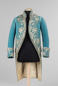 British, 1775 - 89 The elegance and grandeur of 1770s and 80s court dress is displayed in this court coat. The magnificent array and abundance of silver decorations used to adorn the jacket would have sparkled in flickering candlelight and indicated the status of the wearer who could afford such an expensive garment.