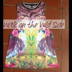 Jungle Tiger Sporty Tank (small & med avail) Bold Mirror Jungle Tiger Tank by Septima. Has a sporty look with hems and breathable fabric. Deep arm circles. Has same print on front and back. New with tags. Don't know much about the brand. Found at a small beach boutique. Perfect for a fierce chic  Tops Tank Tops