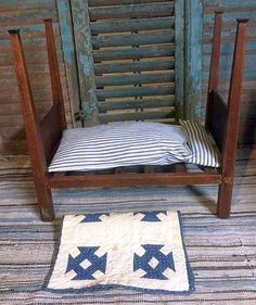 1800'S ANTIQUE WALNUT NY SHAKER DOLL BED WITH CALICO QUILT & TICKING BEDDING.