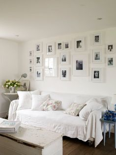 White frames above a white sofa--a clean look for the living room