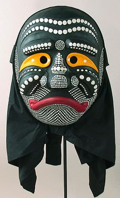 Old Monk Mask. Pyolsandae dance, Yangju, South Korea. Painted wood & cotton hood. In the Yangju Pyeolsandae Nori dance drama this character becomes infatuated with the pretty girl and trys to seduce her. He is an ugly old guy. The dots on his face are supposed to be pox marks. Characters of the dance Most of them are meant to ridicule various professionals and other members of the upper class.