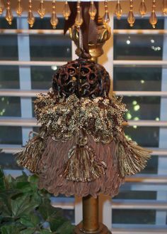 Bronzed Filagree Pumpkin Decorative Tassel. via Etsy.