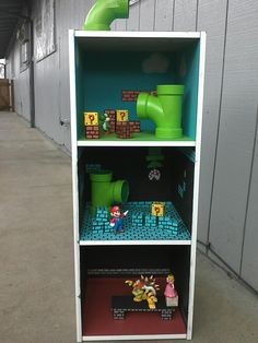 I made a Mario dollhouse for my boys. This picture is from before it was finished but mostly done. Super Mario Room, Super Mario Birthday, Mario Birthday Party, Mario Party, Boy Room, Kids Room, Doll House For Boys, Mario Crafts, Pop Art Decor