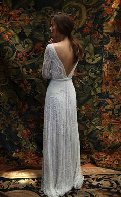 Florence (back), Lihi Hod. Long-sleeved fit and flare gown with V-back and intricate beading. #weddingdress