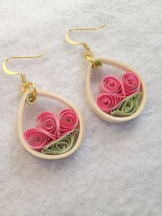 This pretty set of earrings is made using a combination of pink, white and green quilling paper to create a cute flower in a teardrop frame.