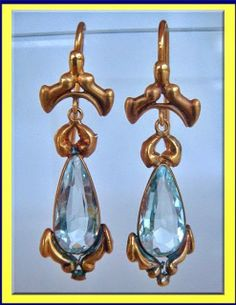 In the Swan's Shadow: Gold repousse & aquamarine earrings, 1835-40