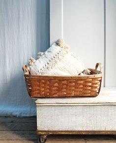 Vintage basket for blankets in living room