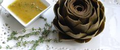 Whole steamed artichokes are an impressive appetizer or side dish, but they're actually very easy to make. Prepare in advance and reheat before serving with the herb-accented lemon sauce.