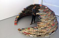 Self-supporting igloo made of books.