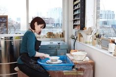 Louisa Taylor at her potter's wheel in her studio in Deptford, south east London.
