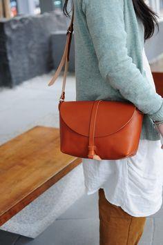 Hand Stitched Light Brown Leather Shoulder Bag/ Carry On Bag. $135.00, via Etsy.