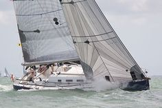 The Beneteau First 40.7 yacht 'Playing Around' racing in the Solent during Cowes Week 2013.