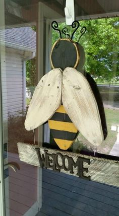 "RECYCLED WOOD PALLETS: So it's Spring, but it feels like Summer outside! We created this Yellowjacket Welcome Door Hanger in honor of the ""bug"" season! I was almost afraid to go outside to take these pictures. Did I mention I am afraid of BUGS. Not this one though, he is cute and huge and if I'm lucky it will chase all the other insects away. It is 24"" tall and 17"" wide and we are selling it for $26. Message us if you would like one for your door . Item # 573 #WoodworkingProjectsBeginner"