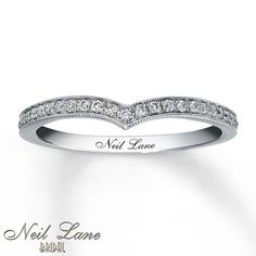 Neil Lane Wedding Band 1/5 ct tw Diamonds 14K White Gold. Two of these would be a great addition to my ring. One on top and one on bottom.