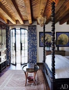 Guest bedroom of designers Andrew Fisher and Jeffry Weisman in a converted 18th-century tannery in San Miguel de Allende. Kravet fabric on windows, amazing ceiling.