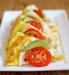 Brunch Quesadillas Another idea: make a simple omelet in a round pan.  Cut in to wedges like in pic and top with tomato and dollop of guacamole.