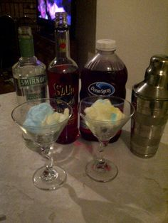 Cotton Candy Cosmo- 1oz green apple vodka, 1oz raspberry sourpuss 3oz cranberry juice -shake and pour over cotton candy....then ENJOY!