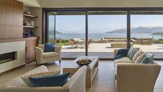 The sliding doors of this living room open onto a patio that almost doubles the living space. Living Spaces, Living Room, Sliding Doors, Building A House, Floor Plans, Patio, Windows, Flooring, Interior
