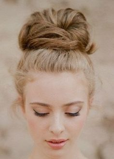 Love this updo for a sweet look, high buns are in! We can add a high bun partway through your shoot if we have time!
