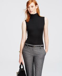 Infinitely wearable, this wool-kissed turtleneck is one of fall's style essentials - in a palette of have-to-have hues. Turtleneck. Sleeveless. Hidden back zipper. Shirttail hem.