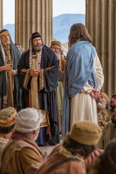 Jesus stands before Caiaphas, and Caiaphas is unable to answer Jesus's questions.