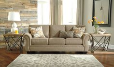 The Tailya Sofa by Ashley Furniture mixes traditional elegance and contemporary simplicity to give you a timeless piece where you can lounge in luxury