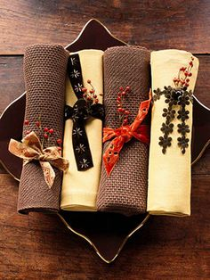 """Great Thanksgiving Napkin setting. You can just go to the hobby store (or JoAnns) get alternating napkin styles and grab a few 'less than a buck"""" ribbons and flourishes. Easy breezy! - Chris"""