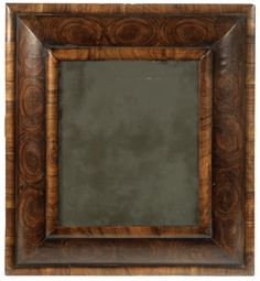 A William and Mary oyster veneered olivewood cushion frame mirror