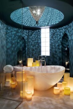 Moroccan styled bathroom decor in Arizona. Beautiful lighting effects from the filigree pendant and the candle holders. #Moroccan #Bathroom #Decor. http://www.mycraftwork.com/