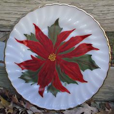 Here is a ten inch plate by Anchor Hocking, Fire King in the golden shell, showcasing a large and bright Poinsettia flower and leaves.   Perfect for