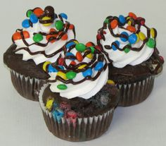Give a big welcome to our latest cupcake, the M&M! It's a Dark Chocolate cake baked with mini M&M's and filled with Hot Fudge.  Topped with our homemade Buttercream, sprinkled with mini M&M's and finished with Chocolate Ganache. #cupcakes #cupcakedesign #cupcakedecorating #mandms #mandmcupcake