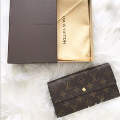 """Authentic Louis Vuitton SARAH NM2 MONOGRAM. Authentic LV monogram wallet. Never been used.Still in box .bought in Paris 2010; made in Spain.again never been used.Coated fabric cowhide leather lining. 7.5""""x 4"""" Looks brand new .Comes with dust cover and box. ❌no Trade Louis Vuitton Bags Wallets"""
