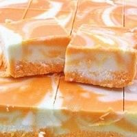 Orange Creamsicle Fudge Recipe ~ Marbled orange and white fudge that tastes just like a creamsicle... yum!