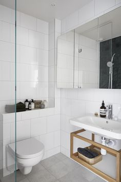 This week you can peek inside a beautiful apartment in Stockholm! We love the modern look in this apartment and the black kitchen is definitely an eye-c. Small Bathroom With Shower, Bathroom Design Small, Laundry In Bathroom, Bathroom Interior Design, White Bathroom, Bathroom Storage, Small Bathrooms, Bathroom Design Inspiration, Bad Inspiration