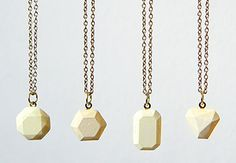 Concrete is an easy to use, accessible material that can be set in moulds to create all sorts of fantastic shapes and details. It's also easy to dye with household materials. These bang-on-trend faceted pastel-hued pendants are made using white concrete and food colouring. | Difficulty: Beginner; Length: Long; Tags: Jewellery, Cement