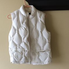 White Gap vest This puffy white vest from The Gap is adorable and a great layering piece! It is fleece lined for extra warmth. GAP Tops
