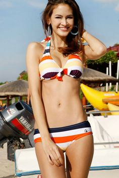 Bikini crafted in nylon and spandex, featuring all over colored stripes, halterneck style, soft-handle cups, bow-knot to chest, a striped blouse.