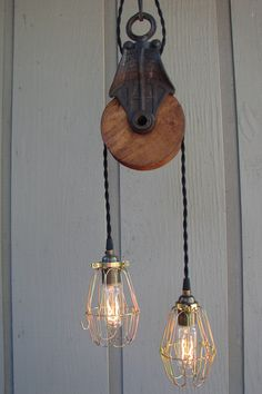 Loving This antique Pulley Light Fixture... Wonder if one of my clients will let me use this in their powder bathroom.