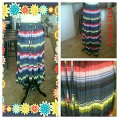 FREE PEOPLE VERSATILE SKIRT OR DRESS Hi low dress/skirt with draw string elastic waist.  100% polyester.   Size removed, but fits size 6 mannequin comfortable.   Waist is flexible and skirt is gathered.   Lots of flexibility in size. Free People Skirts