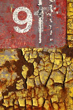 Abstract Decay #9 - An abstract close-up of the numbering on the side of a decaying, old-fashioned petrol pump. The Green Album