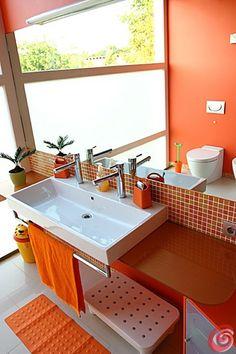 Fresh Clementine bathroom. I like the glass tile backsplash and wall color.